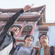 Stock Photo: Three people sightseeing