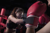 Two female boxers boxing in the boxing ring — Foto de Stock
