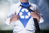 Businessman with recycling symbol underneath — 图库照片