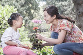 Mother and daughter planting flowers — Stock Photo