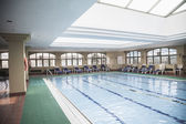 Large, indoor swimming pool with skylight — Stock Photo