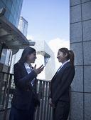 Businesswomen talking outdoors in Beijing — Stock Photo