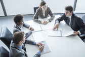 Four business people having a business meeting — Stock Photo