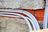 Water pipes in the wall — Stock Photo