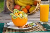 Fruit salad in the orange skin — ストック写真