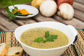 Mushroom cream soup in the white plate — Stock Photo