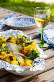 Baked sea bass with vegetables — Stock Photo