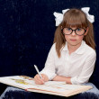 Child wearing black glasses — Stockfoto