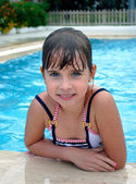 Happy child in the swimming pool — Stock Photo
