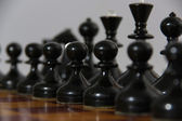 Chess figures on the board — Stock Photo