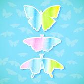 üç çıkartmaları suluboya kelebekler mavi bir arka plan ayarla — Stok Vektör