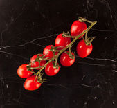 Vine tomatoes on marble table — Stok fotoğraf