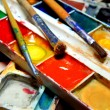 Stock Photo: Paints and brushes close