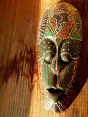 African mask on wood background — Stock Photo