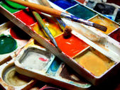 Paints and brushes close — Stock Photo