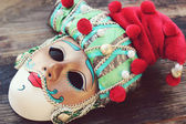 Beautiful venetian masquerade mask in a red hat for the carnival in Venice — Stock Photo