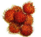 Rambutan fruit with red shell isolated on white background — ストック写真