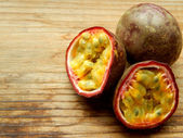 Passionfruit on a wooden table — Stock Photo
