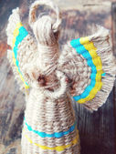 Traditionnal faceless ukrainian doll motanka with angel wings and halo — Stock Photo