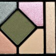 An eyeshadow palette of fifteen colors with three brushes — Stock Photo #46415625