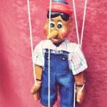 Постер, плакат: A wooden toy marionette Pinocchio