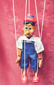 A wooden toy marionette Pinocchio — Stock Photo