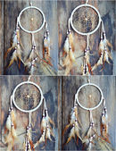 Handmade white dream catcher on wooden background — Stock Photo