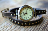 Brown handwatch with a long watchband — Стоковое фото