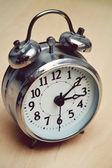 Old fashioned metallic alarm clock — Stock Photo