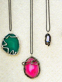 Beautiful necklaces with precious gems — Stock Photo