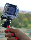 KYIV, UKRAINE - AUGUST 6, 2014: Hand holding small GoPro hero3 camera often used in extreme action video photography. — Stock Photo