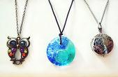 Three beautiful necklaces with precious gems — Stock Photo