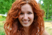 Beautiful young redhead woman smiling happily — Stok fotoğraf
