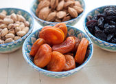 Dried apricots in a ceramic blue bowl . Tasty dried fruits — Stock Photo