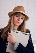 Attractive young woman with  notebook in summer hat — Stock Photo