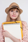 Attractive student girl  with folder and notebook in summer hat — Stock Photo