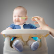 Meal Time. Funny baby refuses to eat. High definition image. — Stock Photo #35570837