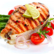 Salmon steak on grilled vegetables — Stock Photo #36559505