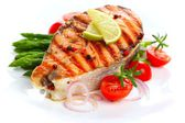 Salmon steak on grilled vegetables — Stock Photo