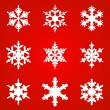 White snowflakes on red background seamless pattern for  — Stock Vector