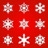 White snowflakes on red background seamless pattern for — Vecteur
