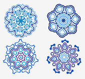 Vector set four beautiful snowflakes — Stock Vector