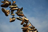 Shoes Hanging from Wire — Stock Photo