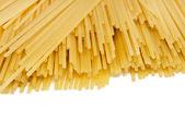 Uncooked spaghetti on a white background — Foto de Stock