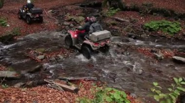 Quadbikes crossing river — Stock Video