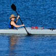 Cute young woman kayaking in California — Stock Photo