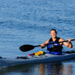 Kayaker arrives squinting in the bright sunlight — Stock Photo