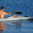 Stock Photo: Kayaker paddling off