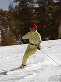 A young woman skiing — Stock Photo