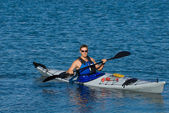 Atheltic man in a sea kayak — Foto Stock
